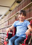 Disabled School girl in education library in wheelchair. Digital composite of Disabled School girl in education library in wheelchair stock image