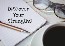 Discover your strengths text written on page with glasses and coffee. Digital composite of Discover your strengths text written on page with glasses and coffee Stock Image
