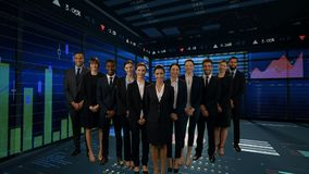 Business people standing in a room with graphs stock footage