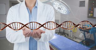 Doctor with 3D DNA strand stock images