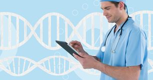 Doctor man using a tablet with 3D DNA strand Royalty Free Stock Photo