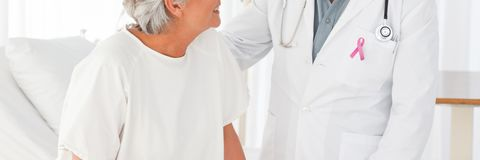 Doctor man with breast cancer awareness ribbon with patient. Digital composite of Doctor men with breast cancer awareness ribbon with patient Stock Photos