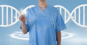 Doctor woman pointing with DNA strand. Digital composite of Doctor woman pointing with DNA strand royalty free stock image