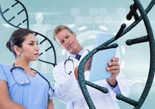 Doctors with 3D DNA strands Stock Photography