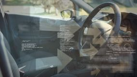 Drivers seat. Digital composite of the drivers seat while arrows move in the background stock footage