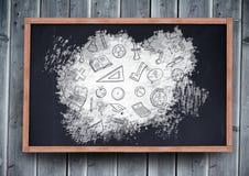 Education graphics icons on blackboard. Digital composite of education graphics icons on blackboard royalty free stock photo