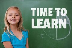 Education and time to learn text and girl standing against a blackboard Stock Photos