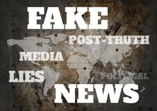 Fake news and associated text over world map grunge background. Digital composite of Fake news and associated text over world map grunge background Royalty Free Stock Photography