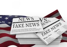 Fake news newspapers stacked over USA flag Royalty Free Stock Photos