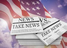 Fake news newspapers stacked up with USA flag Royalty Free Stock Image