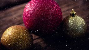 Falling snow with Christmas bauble decorations stock video footage