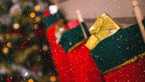 Falling snow with Christmas stockings decoration. Digital composite of Falling snow with Christmas stockings decoration stock video
