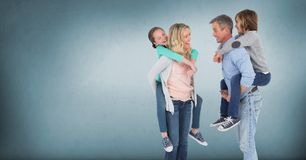 Family giving piggybacks with blue background royalty free stock photography