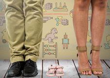 Father and mother's legs with child's shoes sandals with toys graphics stock photos