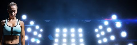 Fit athletic woman with stadium lights. Digital composite of Fit athletic woman with stadium lights Stock Photos