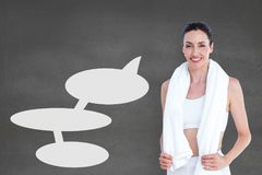 Fitness woman with speech bubbles standing against grey background Stock Photography