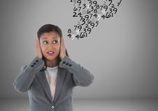 Frustrated woman doing calculations. Digital composite of frustrated woman doing calculations royalty free stock photography