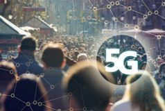 5G or LTE presentation. Barcelona modern city on the background. Digital composite of 5G with Crowd of anonymous people walking on the Rambla of Barcelona on the Royalty Free Stock Image