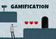 Gamification text and Man in Computer Game Level with hearts and trap. Digital composite of Gamification text and Man in Computer Game Level with hearts and trap Royalty Free Stock Photo