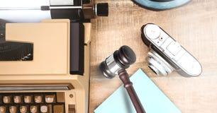 Gavel camera and typewriter on desk Royalty Free Stock Photography