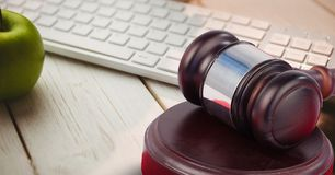 Gavel and keyboard with apple. Digital composite of Gavel and keyboard with apple Royalty Free Stock Images