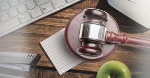 Gavel and keyboard on desk. Digital composite of Gavel and keyboard on desk Royalty Free Stock Images