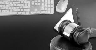 Gavel and keyboard on desk. Digital composite of Gavel and keyboard on desk Royalty Free Stock Photography