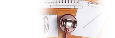 Gavel and keyboard on desk with transition. Digital composite of Gavel and keyboard on desk with transition Royalty Free Stock Images