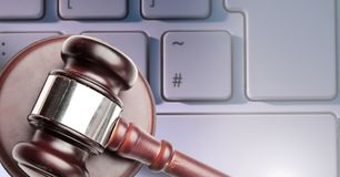 Gavel and keyboard. Digital composite of Gavel and keyboard Royalty Free Stock Images