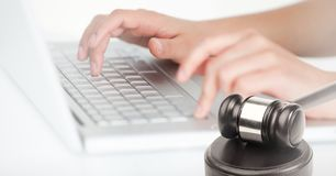Gavel and keyboard on laptop. Digital composite of Gavel and keyboard on laptop Royalty Free Stock Photography