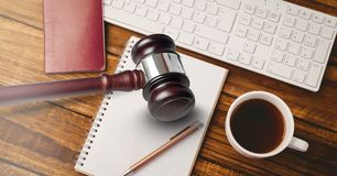 Gavel and keyboard with notepads and coffee on desk. Digital composite of Gavel and keyboard with notepads and coffee on desk Royalty Free Stock Image
