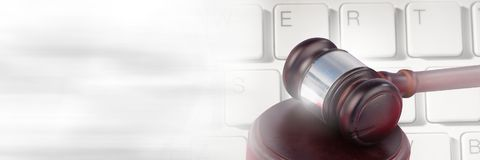 Gavel and keyboard with transition. Digital composite of Gavel and keyboard with transition Stock Photo