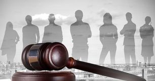 Gavel and people silhouettes over city Royalty Free Stock Photos