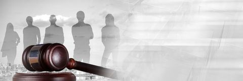 Gavel and people silhouettes over city with transition stock photos