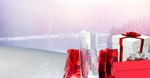 Gifts in Christmas Winter landscape. Digital composite of Gifts in Christmas Winter landscape Royalty Free Stock Photo