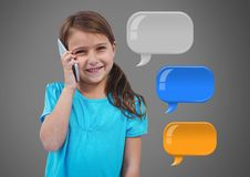 Girl against grey background with phone and chat bubbles Royalty Free Stock Photography