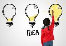 Girl drawing light bulbs idea. Digital composite of Girl drawing light bulbs idea Royalty Free Stock Photography