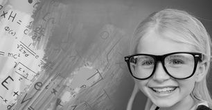 Girl with glasses next to equations theory on blackboard Royalty Free Stock Images