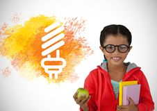 Girl holding books and apple with colorful light bulb graphic Stock Photos