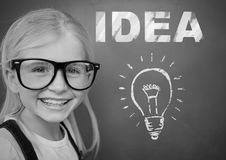 Girl with idea text and light bulb royalty free stock photo
