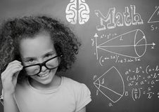 Girl pointing at math equations on blackboard. Digital composite of Girl pointing at math equations on blackboard stock photography