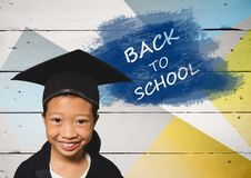 Girl wearing graduation hat with back to school text Stock Photo