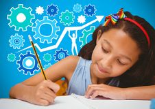 Girl writing in front of blue blank background with settings cog icons graphics Stock Image
