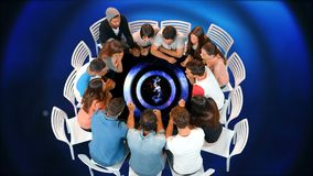Group of people seated in a circle table. Digital composite of a group of diverse people seated in a circle table while table shows a countdown from 10 stock video