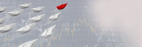 Group of Paper boats on statistic charts background Royalty Free Stock Photo