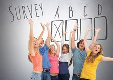 Group of students standing in front of Survey box ticked graphics. Digital composite of Group of students standing in front of Survey box ticked graphics stock images
