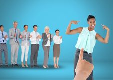 Hand choosing a business woman on blue background with business people. Digital composite of Hand choosing a business women on blue background with business Stock Image