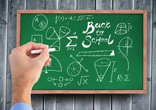 Hand drawing back to school diagrams on blackboard. Digital composite of Hand drawing back to school diagrams on blackboard Stock Photos