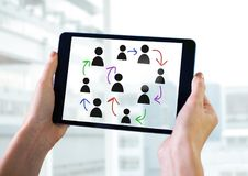 Hand-drawn people profile icons with hands holding tablet. Digital composite of Hand-drawn people profile icons with hands holding tablet Stock Photography