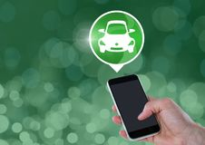 Hand holding phone with car icon Stock Photo